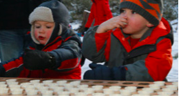 Children drinking maple syrup
