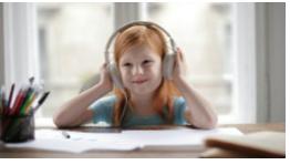 Little girl with headphones on
