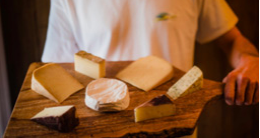 Man holding a cheese plate