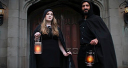 Two people holding a lantern