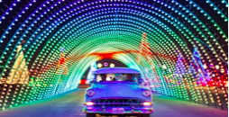 Car driving through a tunnel of lights