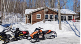 Snowmobiles parked in the snow