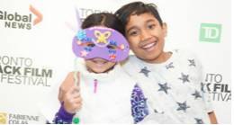 Kids wearing a party mask