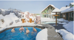 People sitting in outdoor hot tub in winter
