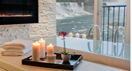 Candles overlooking a view of waterfall