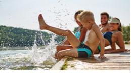 Kids splashing on a dock
