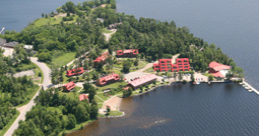 Birds eye photo of lakefront with buildings