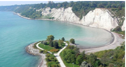 Ariel view of a body of water and cliffs