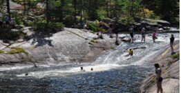 People sliding down a waterfall