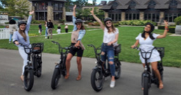 A group of girls on motorized bicycle's
