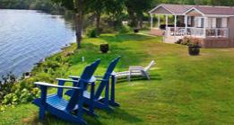 Muskoka chairs overlooking a lake