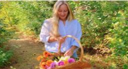 Women holding a basket of flowers